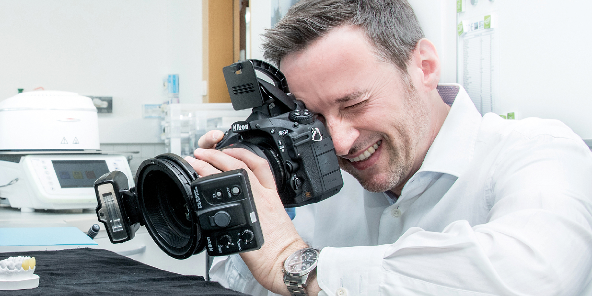 What aspects should you pay attention to when photographing dental restorations in the lab?